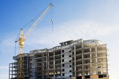 Building under construction. Blue sky on background stock image