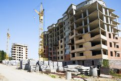 Building under construction. Blue sky at background royalty free stock image