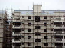 Building under construction. Housing building under construction or undergoing repairs with scaffolding Royalty Free Stock Image