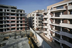 Building Under Construction. Residential district with new blocks under construction Stock Images