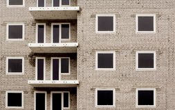 Building under construction abstract. Block of flats under construction close-up. Building detail, brick wall with windows, as pattern Royalty Free Stock Images