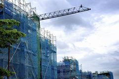 Building under construction against blue sky Royalty Free Stock Photo
