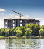 Building under construction on the bank of big lake Stock Photography