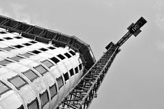 Building under construction.Black and white. High-rise building under construction. The site with cranes against blue sky Stock Photo