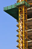 Building under construction and blue sky Royalty Free Stock Images