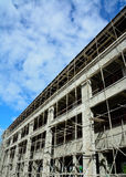Building under construction with cloudy blue sky Royalty Free Stock Photography