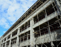 Building under construction with cloudy blue sky Stock Photography