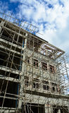 Building under construction with cloudy blue sky Royalty Free Stock Photos