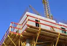 A building under construction with colored scaffolding Stock Photo