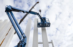 Building under construction. Columns. Cranes Stock Photo