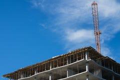 Building under construction and crane Stock Photos