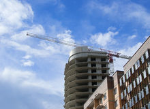 Building under construction with a crane Royalty Free Stock Photos