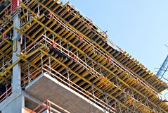 Building under construction. New building under construction with brick work and wooden scaffolding Stock Photos