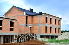 Building under construction. Construction of a new house made of bricks stock image
