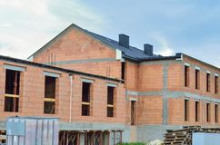Building under construction. Construction of a new house made of bricks royalty free stock photo
