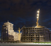 Building under construction at night. Urban high-rise building under construction at night Stock Image