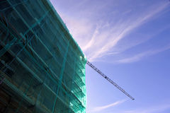 Building under construction, scaffolding, cranes Royalty Free Stock Photo