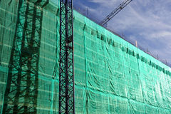 Building under construction, scaffolding, cranes Royalty Free Stock Image