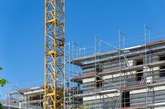 Building under construction - scaffolding at the facade stock photo