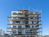 Building under construction - scaffolding at the facade stock images