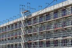 Building under construction - scaffolding at the facade stock photos