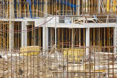 Building under construction. Scaffolding structure. Architecture. Horizontal stock photo