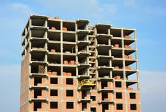 Building under Construction Site. Building a House. Close up on Building under Construction Site. Building a House Stock Photo