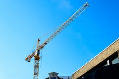 Building under construction. The site with cranes against blue s. Ky, reconstruction project stock photography