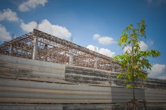 Building under construction in the site surrounded with zinc fence. Building under construction in the site surrounded with zinc fence with blue sky background royalty free stock images