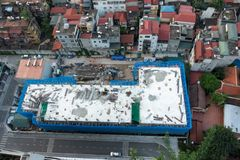 Building under construction from the top view in Hanoi, with many surrounded residential houses.  Royalty Free Stock Images