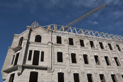 Building under construction and tower crane boom Royalty Free Stock Image