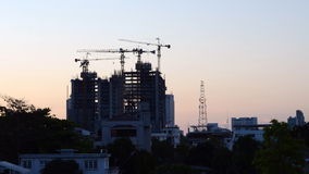 Building Under Construction at twilight time, Timelapse. Video stock footage