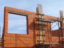 Building under construction. Wall tile just built by construction company Stock Photos