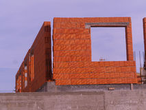 Building under construction. Wall tile just built by construction company Stock Image