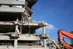 Building under demolition. With heavy machinery Stock Photography