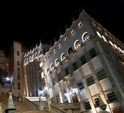 building of the University of Guanajuato at night, viewed from below stock photography