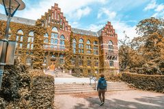The building of the University Library in Lund, Sweden. The building of architecture overgrown with greenery stock image