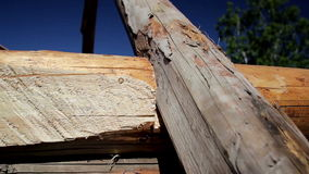 Building up a old historic cabin log house using a log Stock Photos