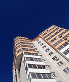 Building, view from the bottom. Brick building, view from below, a beautiful blue sky Stock Photos