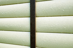 Building wall covered with beige siding panels protect house wall Royalty Free Stock Photo