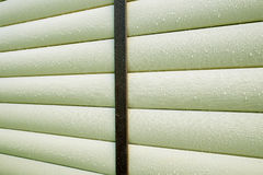 Building wall covered with beige siding panels protect house wall Stock Photography