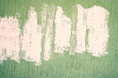 Building wall covered with green stucco and chaotic white paint lines on it Stock Photos