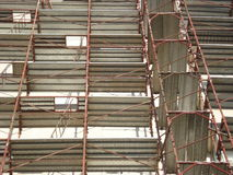 Building wall covered with scaffolds Stock Photography