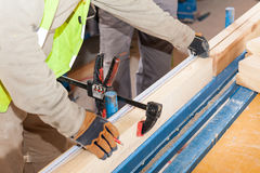 Building a wall for frame house. Worker make marks for cutting timber. Stock Image