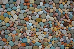 Building wall made of colored stones Stock Photo