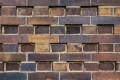 Free Building Wall Made Of Dark, Yellow To Brownish Clinker Bricks With Various Alternating Patterns. The Stones Are Offset In Rows, Stock Images - 140015104