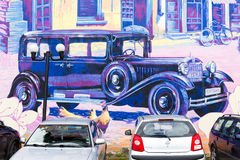 Building wall street art painting old car Stock Photos