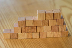 Building a wall from wooden bricks for construction or landscaping to create something with a blueprint and good plan. royalty free stock photography