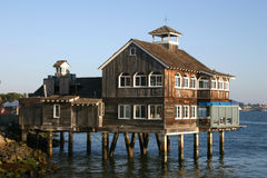 Building On The Water. Wood building built over water royalty free stock photo