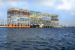 Building on water in Amsterdam. Stock Photo